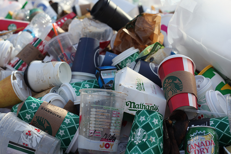 Assorted trash with mostly plastic and paper cups