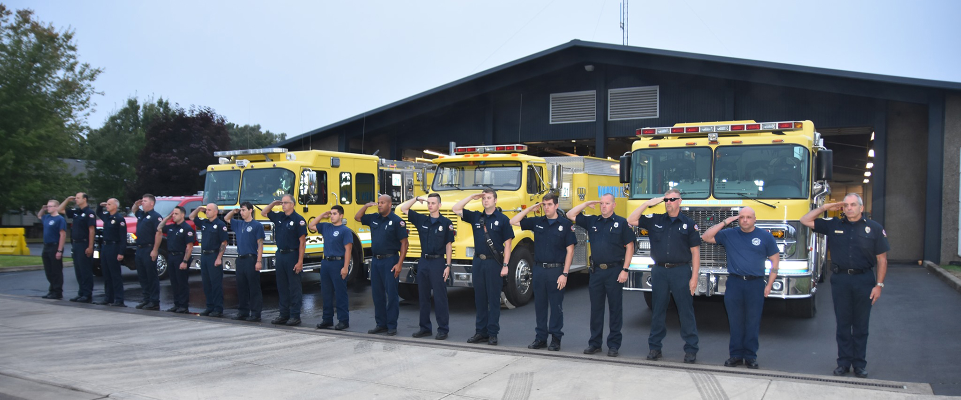 Group of firefighters saluting