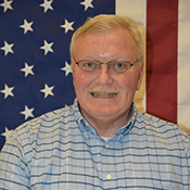 Jerry Cotter portrait with American flag background