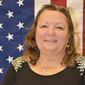 Deb Yager portrait with American flag background